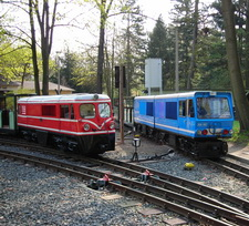 Picture with two battery-electric locomotives
